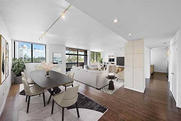 Photo #7 Light and bright, this condo has a comfortable floor plan. The living room flows effortlessly into the formal dining and kitchen space. Step out into the balcony through the sliding glass doors to enjoy the stunning Galleria views.