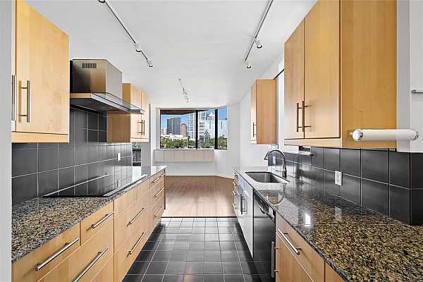 Photo #9 The beautiful and functional kitchen opens to the breakfast area, so you can serve meals right after preparing them. Perfect when enjoying breakfasts and quick snacks during the day.