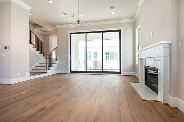 Photo #4 Photo from a similar InTown Home. Note the expansive living area and the glass retractable sliders!NO FIREPLACE