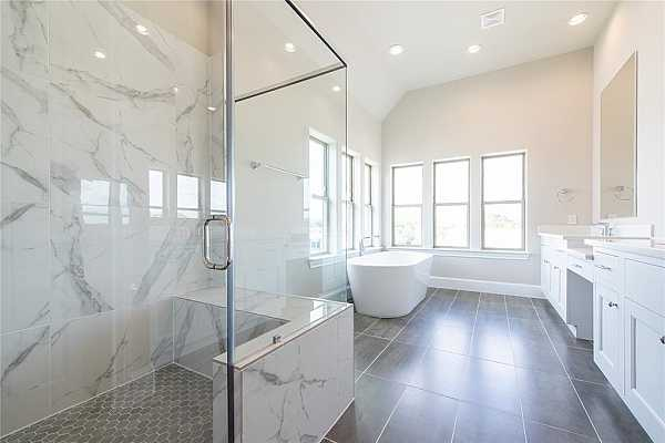 Photo #5 Similar floor plan with floating tub and separate shower with bench seat. Beautiful!