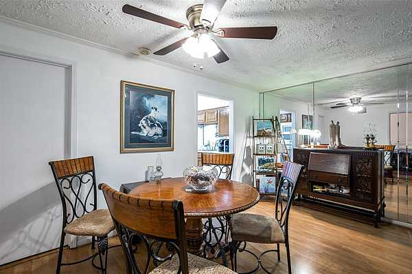 Photo #7 Dining is convenient to the kitchen and living area
