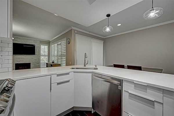 Photo #10 Stainless steel appliances pair well with the crisp white cabinets and subway tile backsplash.