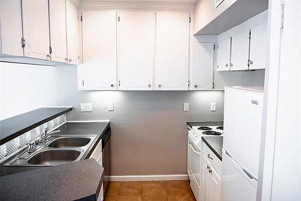 Photo #4 This all-white kitchen is perfect for all your cooking needs! Comes complete with all white appliances and a double sink!