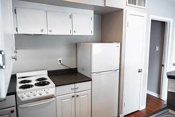 Photo #5 This kitchen has tons of cabinet space and counter space perfect for your cooking needs!