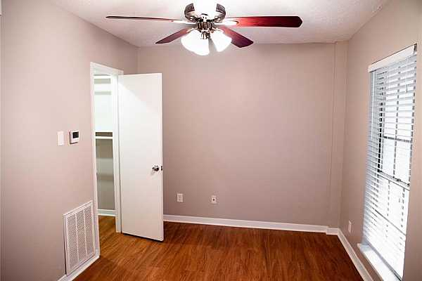 Photo #7 This bedroom has lots of light and no carpet!