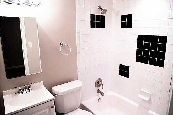 Photo #9 This bathroom has all white finishes throughout and comes complete with a shower and tub! The subway tile, cabinets and countertops have been recently updated!