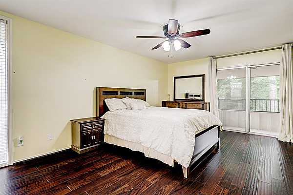 Photo #11 Alternate view of master bedroom with sliding door that leads to balcony.