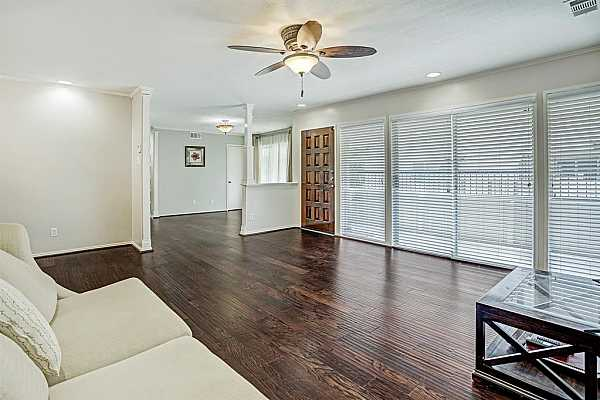 Photo #4 Light and bright second story condo with living and dining areas and an additional den/study area.