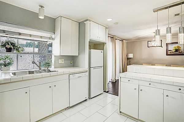 Photo #6 Kitchen with recessed lighting, breakfast bar and tile flooring.