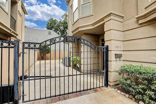 Photo #3 Private and gated. The front door is behind the gate.