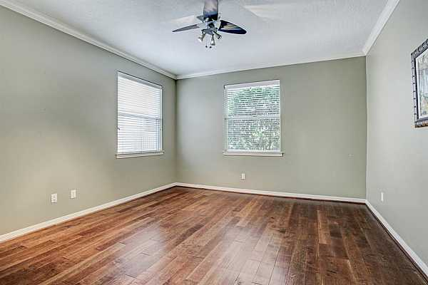 Photo #5 Secondary, downstairs bedroom is a good size. All the bedrooms have hardwood floors.