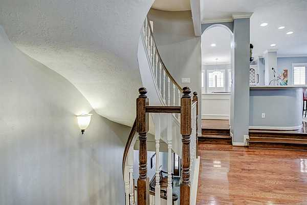 Photo #6 Not your usual cookie cutter townhome- lots of architectural details that make it a standout. Notice the curved staircase!