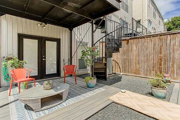 Photo #7 French doors open onto the patio from the first-floor flex room.  The home flows seamlessly from inside to outside allowing you to take optimal advantage of the backyard.
