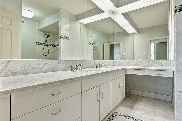 Photo #12 Master bath with fresh white cabinets, marble counters and timeless hardware.