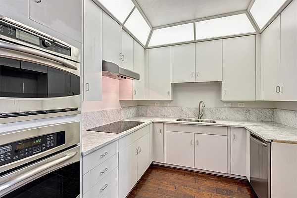 Photo #4 Light and bright kitchen offers marble counter tops, and stainless steel appliances.