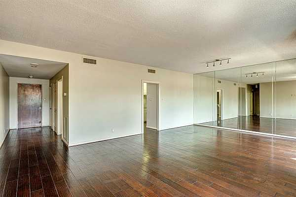 Photo #5 This main living space offers a variety of furniture placement options due to the vast layout.