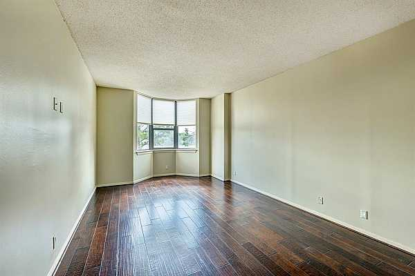 Photo #10 Primary bedroom has a bay window which offers natural light throughout the room.