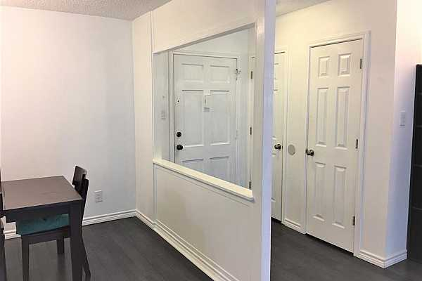 Photo #3 Entry hall with 2 closets open to dining room