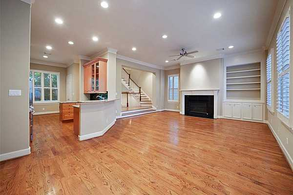 Photo #3 Living Room - view 1 - this large living space offers soaring 11ft ceilings, wide plank select grade White Oak flooring, extensive recessed lighting and numerous large double hung wood windows which surround the space and let in plenty of natural light.