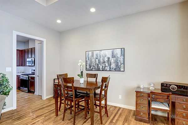 Photo #12 EXPANDABLE DINING ROOM.  CAN ACCOMODATE A LARGER TABLE.  GREAT WALL SPACE.