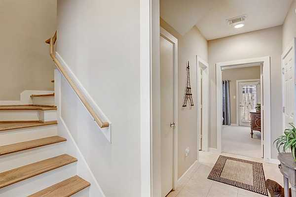 Photo #5 AS YOU ENTER YOU HAVE VIEW OF FOYER AND STAIRCASE WITH OAK TREADS