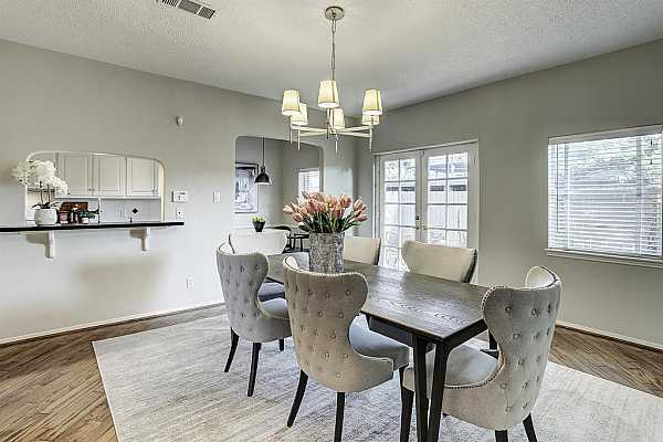 Photo #12 This view of the Dining Room highlights the French doors to the Patio/Garden area.