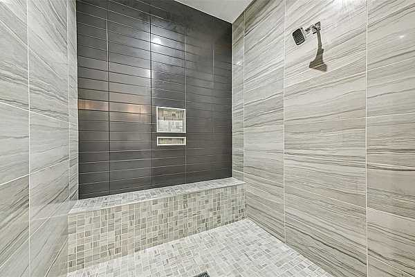 Photo #12 Primary Bath includes Oversized Shower with bench.