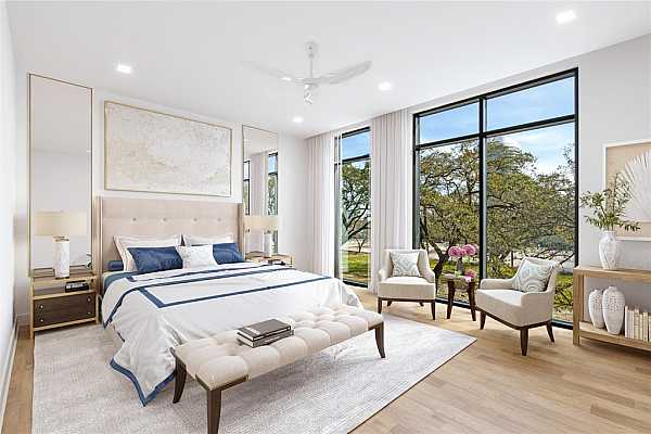 Photo #5 Sun-filled primary bedroom with oak tree view and direct balcony access.