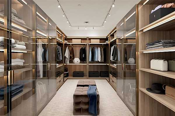 Photo #7 Oversized primary closet with lush carpeting and boutique lighting.