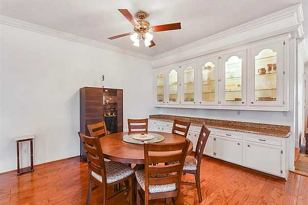 Photo #7 Dedicated Dining Room made for hosting. Gorgeous granite countertops, built-in-buffet, and an abundance of cabinet and counter space!