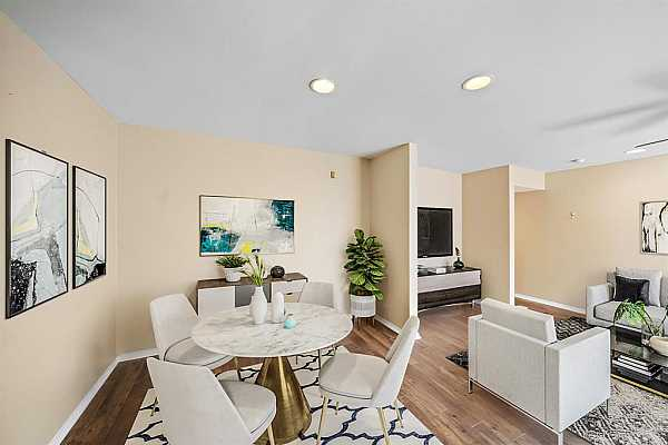 Photo #3 Add a modern round table at the breakfast nook for a contemporary look. Great open space to enjoy meals with family and friends! This photo has been virtually staged to show furniture possibilities.
