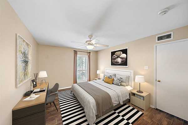 Photo #5 The secondary bedroom is a great space for a bed, desk, and two nightstands. The blank canvas allows you to make the space your own. This photo has been virtually staged to show furniture possibilities.