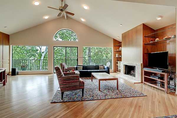 Photo #6 Gorgeous, narrow plank white oak flooring installed on the diagonal in all areas on this level. View into the trees and beyond at the Buffalo Bayou is so peaceful.