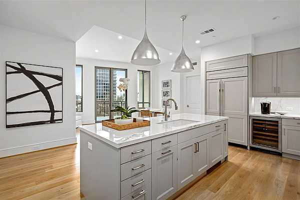 Photo #8 Informal living just off the kitchen lends to optimal space multi-functionality.