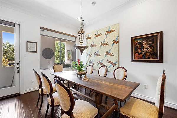 Photo #6 The dining space can fit an 8-person dining table.