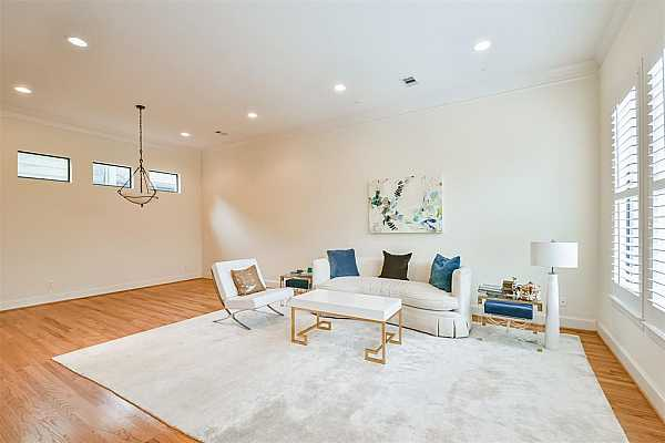 Photo #5 Beautiful light filled living spaces throughout this open floor plan.