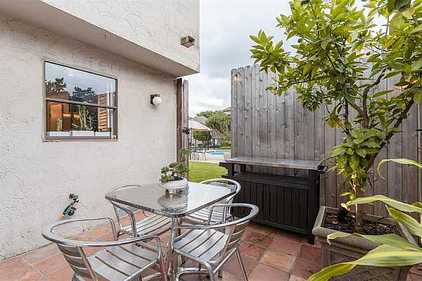 Photo #11 Enjoy breakfast in your private patio while overlooking the backyard.