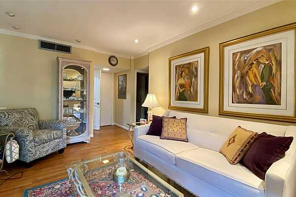 Photo #5 Alternate view of the living room with the perfect recessed lighting to showcase artwork on the wall or furniture