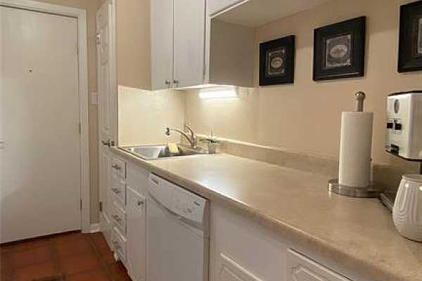 Photo #9 This kitchen has plenty of cabinet space and includes a food pantry as well