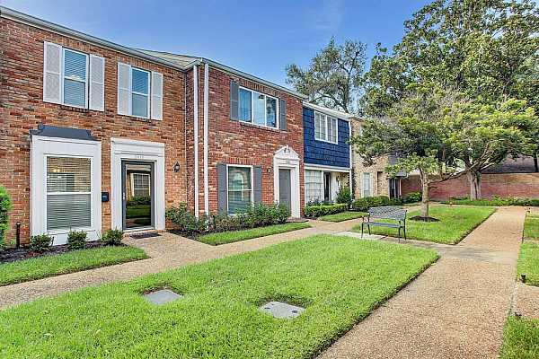 Photo #3 This charming Briargrove two-bedroom, one-and-a-half-bathroom townhome offers generous scale, private outdoor space and great storage on two spacious levels.