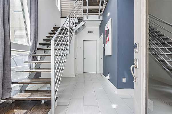 Photo #3 The crown jewel and centerpiece of this impressive 4 story townhome is a contemporary designed floating staircase with timeless wood treads complemented by sleek metal railings and handrails.