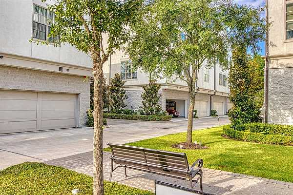 Photo #4 The common green space within the gated enclave offers a peaceful break from the hustle and bustle of the city and is a great place to walk the dog and meet your neighbors.  This unit is truly one of very best locations in the entire community (townhome is located across the main drive with the garage door open).