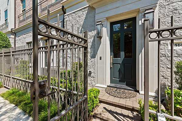 Photo #5 The gracious front door flanked by gas lanterns sets the tone for the home