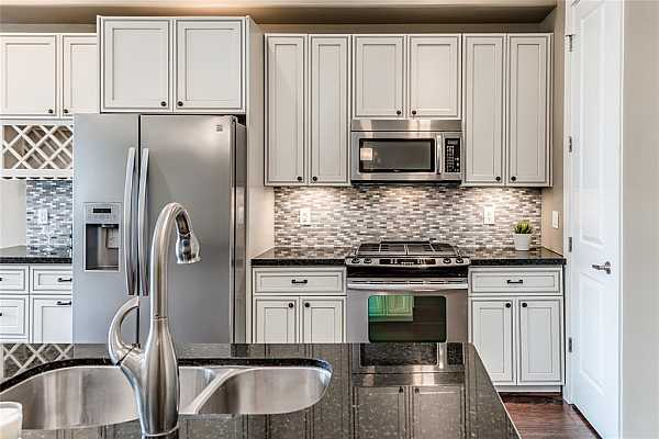 Photo #11 Kitchen features granite countertops, Whirlpool stainless steel appliances, gas range (rare to find in condos), and a walk-in pantry. Ergonomically designed in a work triangle for ease of movement.