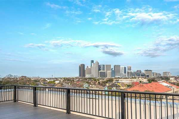 Photo #7 Just one of the many skyline views you can see of Houston from the rooftop terrace.  Recently re-decked and ready for your next event!