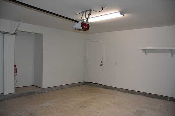 Photo #5 More garage with storage space.