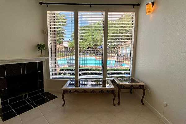 Photo #5 The pool is right right outside your front door and offers a great view right from your living room