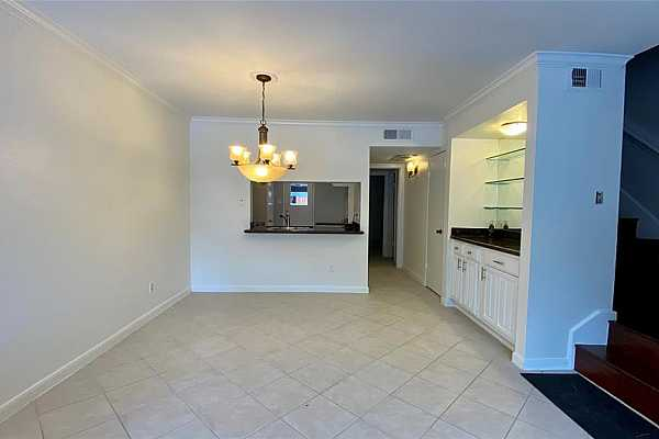 Photo #6 This open dining room has plenty enough space for entertaining guests and opens up to the living room