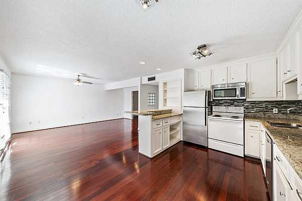 Photo #7 This spacious 1-bedroom condo has great flow and openness to it.