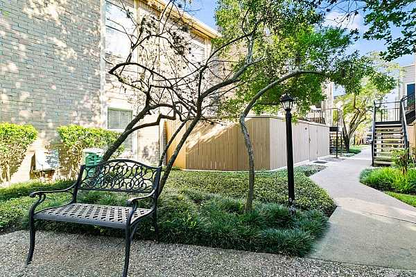 Photo #1 Beautiful community with private patios and lush walkways close access to Galleria and nearby restaurants and shopping.
